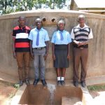 The Water Project: Bumuyange Secondary School -  Posing With Tank