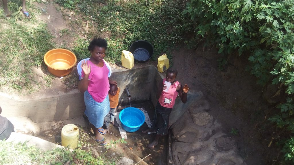 The Water Project : kenya4701-rose-achina-with-lavine-khalachi