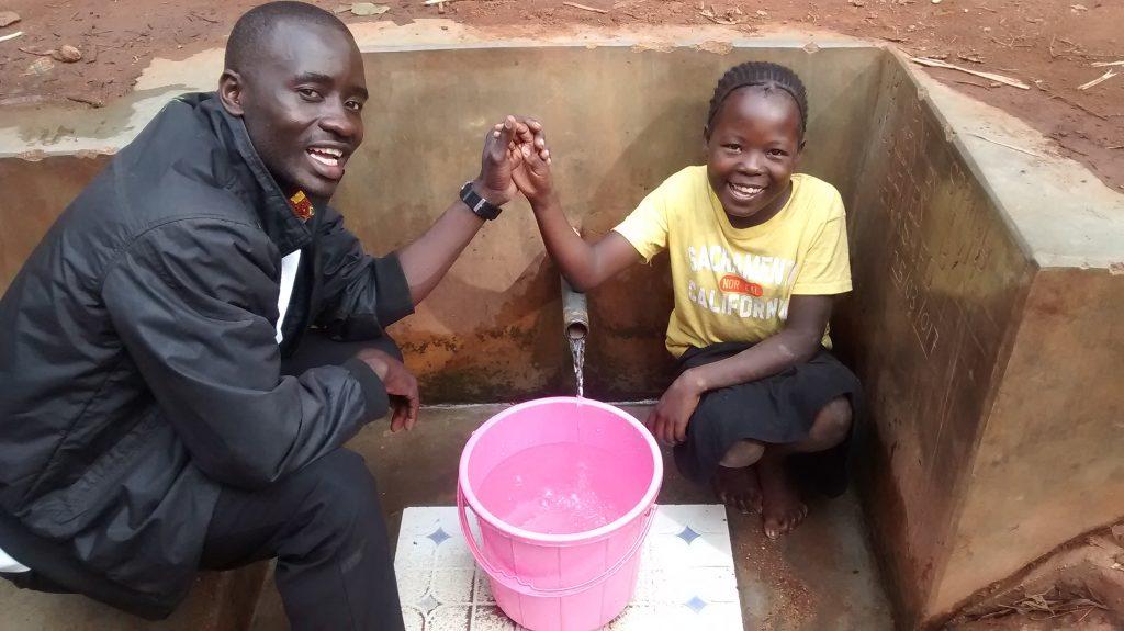 The Water Project : kenya4702-erick-wagaka-and-angel-makokha