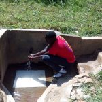The Water Project: Bumavi Community, Shoso Mwoga Spring -  Collecting Water