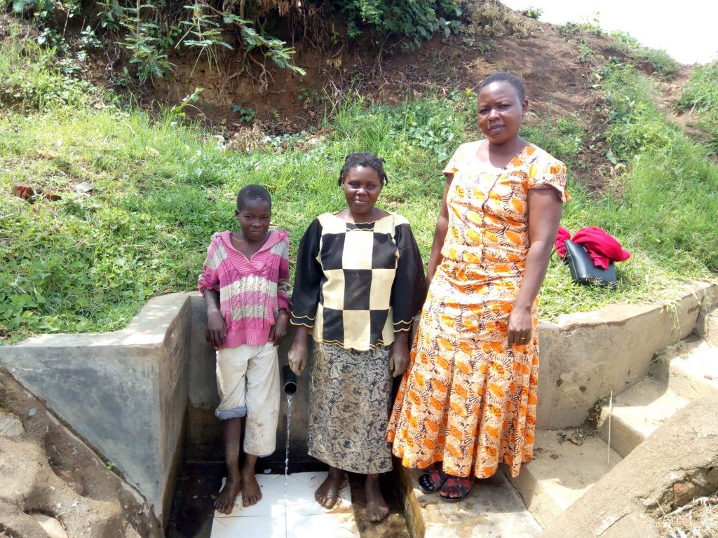 The Water Project : kenya4705-betty-muhongo-poses-with-brendah-and-chomba-at-the-spring