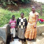 The Water Project: Shitoto Community, Abraham Spring -  Betty Muhongo Poses With Brendah And Chomba At The Spring