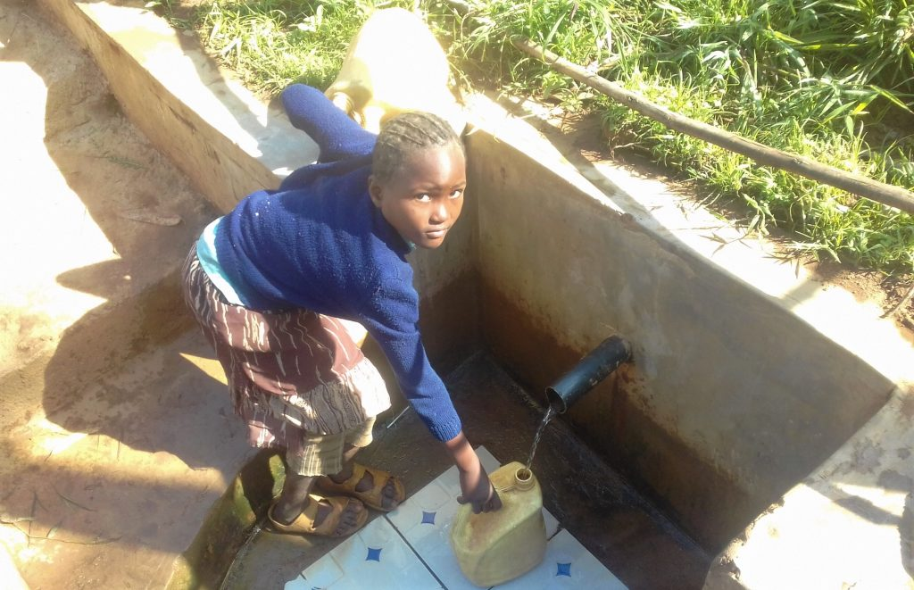 The Water Project : kenya4707-filling-jerrican-with-water