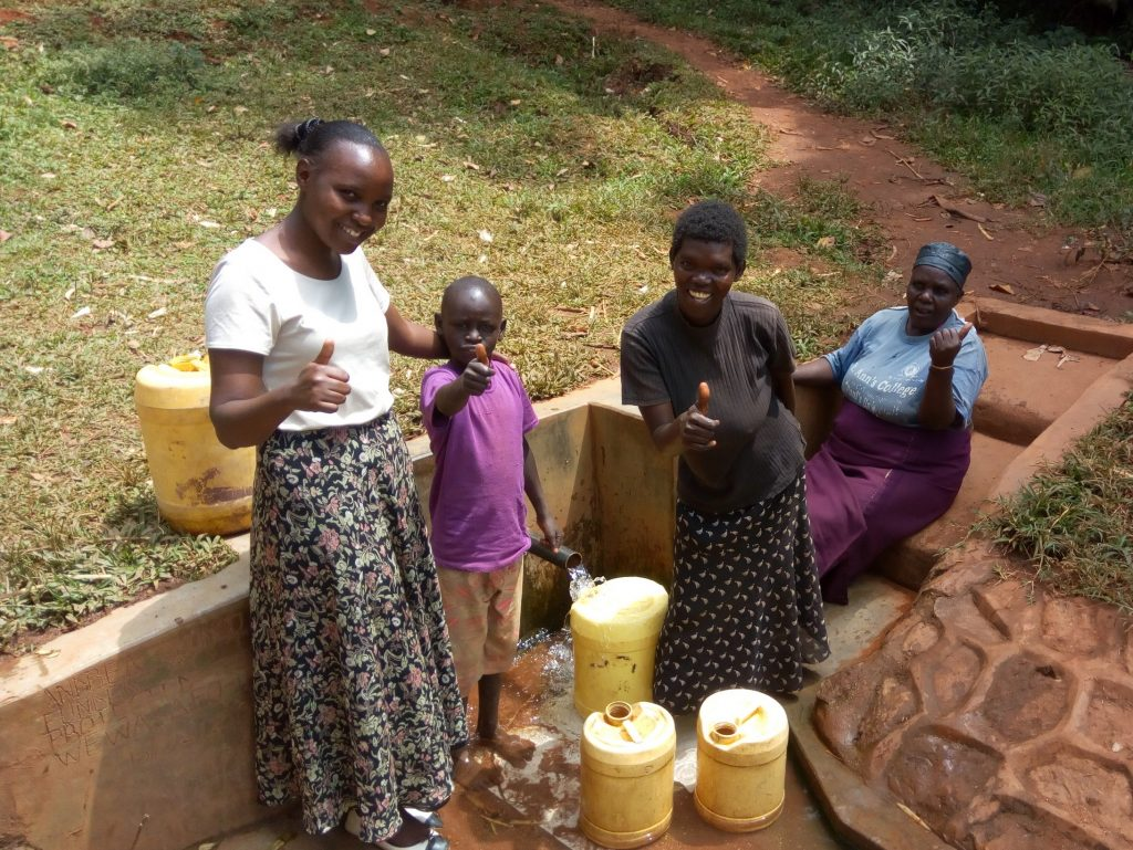 The Water Project : kenya4709-wewasafo-staff-pose-with-community-members-at-andrea-kongo-spring