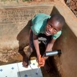 The Water Project: Eluhobe Community -  Reliable Water Flowing