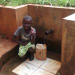 The Water Project: Nyira Community, Ondiek Spring -  Precious Fetches Water