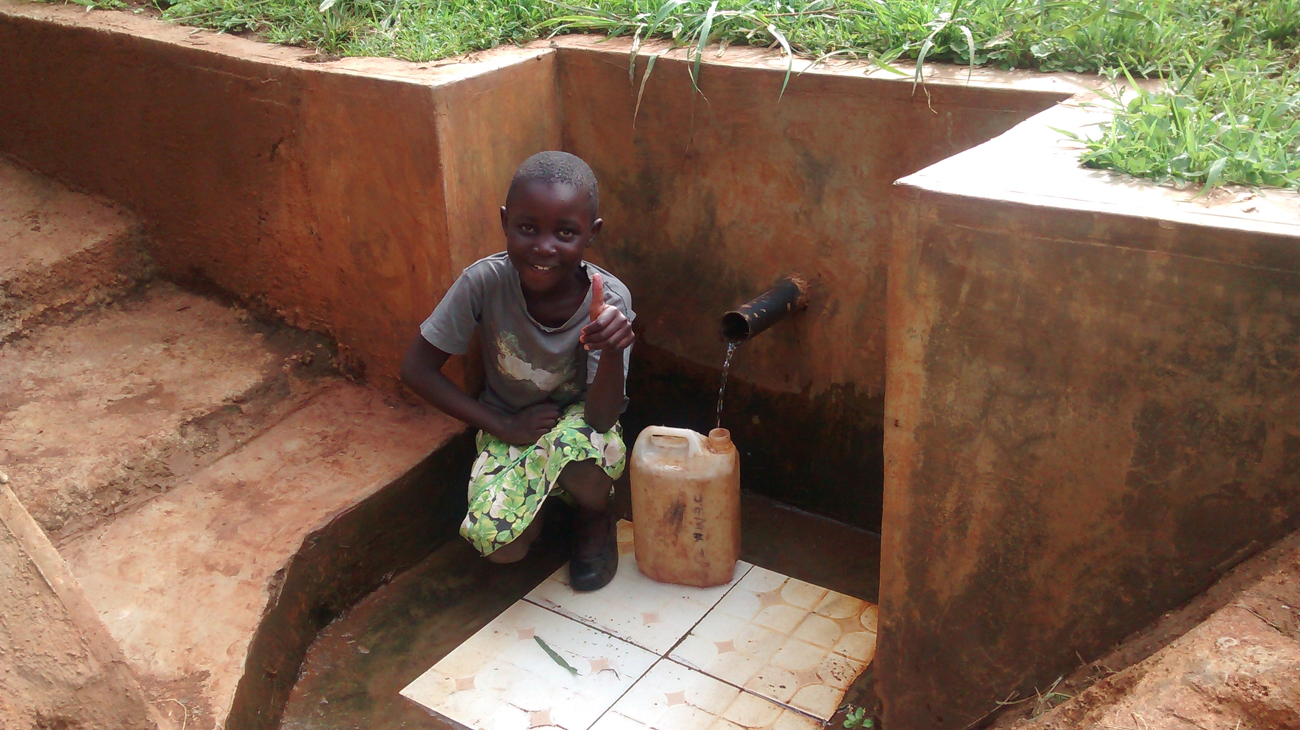 The Water Project : kenya4719-precious-fetches-water