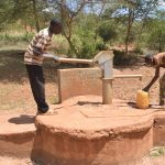 The Water Project: Mbindi Community B -  Collecting Water At Well