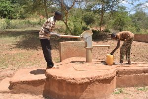 The Water Project:  Collecting Water At Well