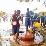 The Water Project: Mukunyuku RC Primary School -  Students Getting Water