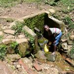 The Water Project: Ikoli Primary School -  Someone Fetching Water