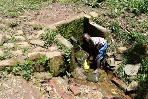 The Water Project:  Someone Fetching Water