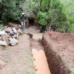 The Water Project: Mbau Community -  Sand Dam Trench