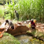The Water Project: Mukhangu Community, Okumu Spring -  Spring Protection Construction