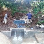 The Water Project: Irumbi Community -  Spring Protection Construction