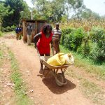 The Water Project: Shina Primary School -  Director Catherine Shuttling Water To The Site