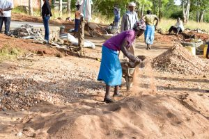 The Water Project:  Sifting Sand For Tank Construction