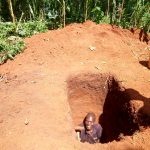 The Water Project: Irumbi Community, Okang'a Spring -  Sinking A Pit For The New Sanitation Platform