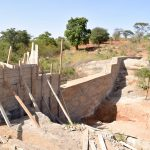 The Water Project: Ilandi Community -  Sand Dam Construction