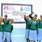 The Water Project: Kithumba Primary School -  Happy Students