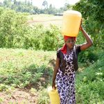 The Water Project: Mungakha Community, Nyanje Spring -  Jackline Carrying Water