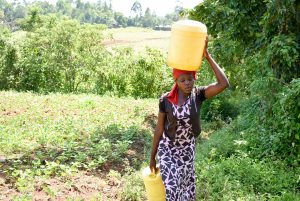 The Water Project:  Jackline Carrying Water