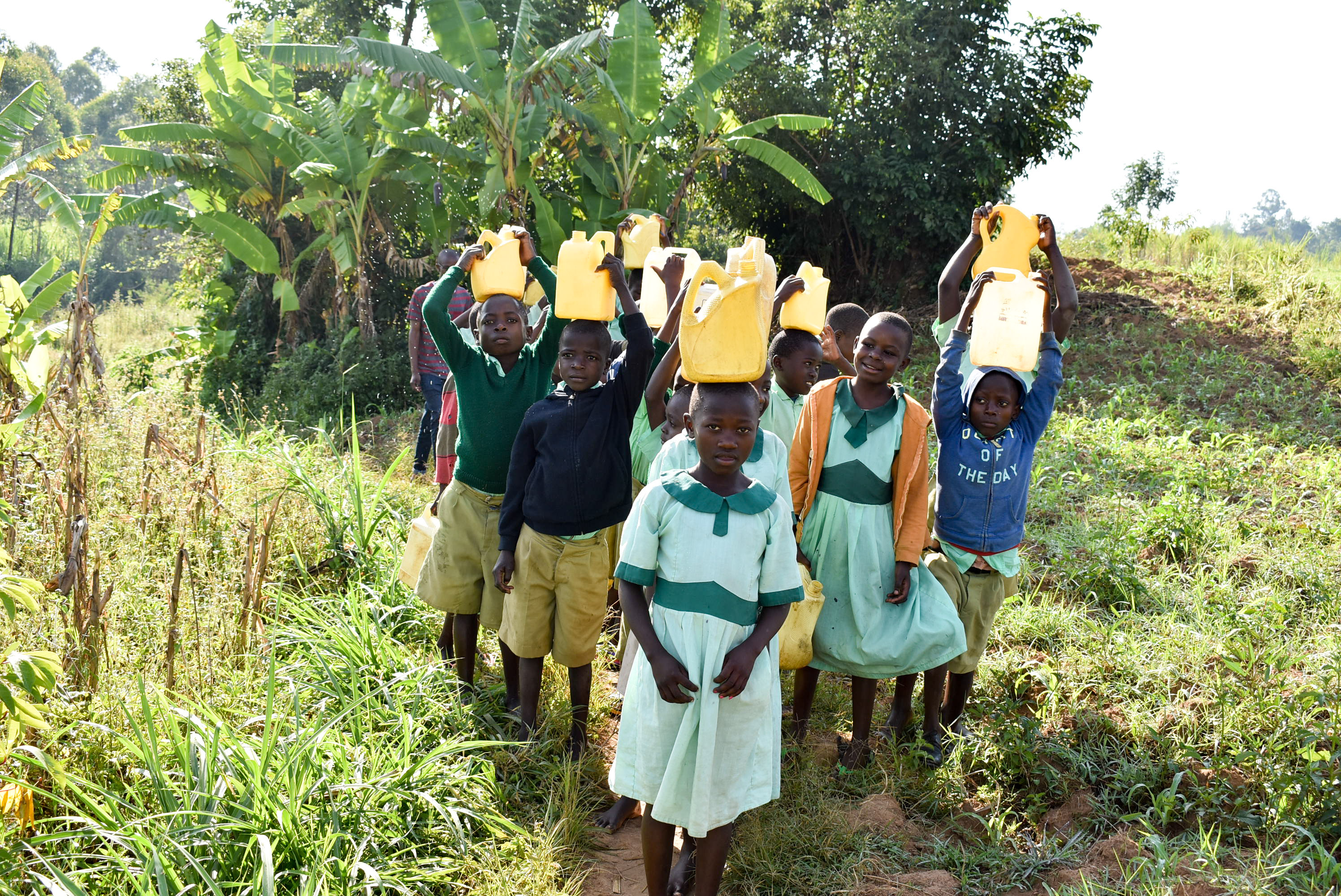 The Water Project : 5-kenya18310-carrying-water-back-to-school