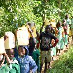 The Water Project: Eshikufu Primary School -  Carrying Water Back To School