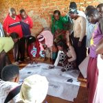 The Water Project: Pakanyi Gwoki Community -  Committee Members Analyzing Spread Of Germs