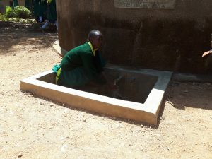 The Water Project:  Ruth Ambia At The Water Tank