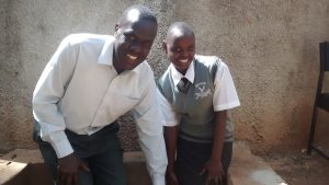 The Water Project:  Edwin Odali With Achieng Violet At The Water Point