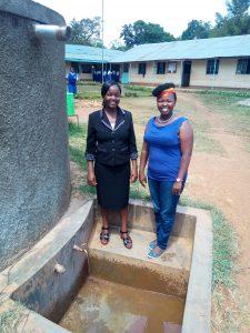 The Water Project:  Deputy Head Gaudencia Takaundo With Wewasafo Staff Jacky Chelagat