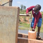 The Water Project: Mbuuni Community A -  Fetching Water