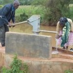 The Water Project: Ngaa Community -  Pumping Water