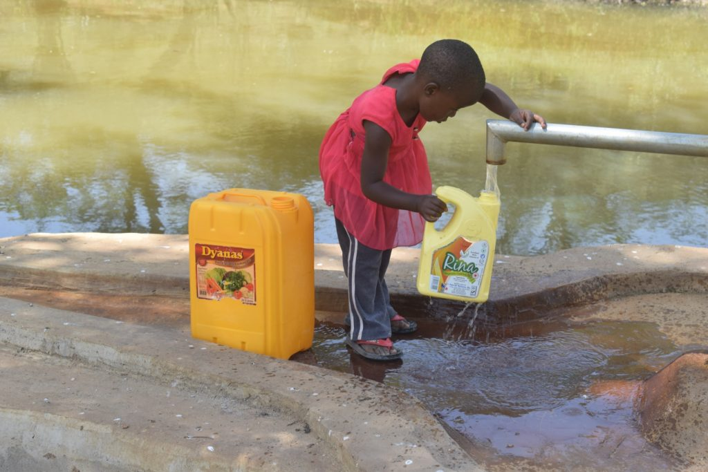The Water Project : kenya4766-filling-container-with-water