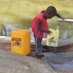 The Water Project: Ilinge Community -  Filling Container With Water