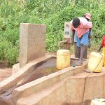 The Water Project: Ikulya Community A -  Fetching Water