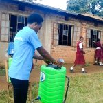 The Water Project: Shikhondi Girls Secondary School -  Trainer Setting Up Handwashing Station