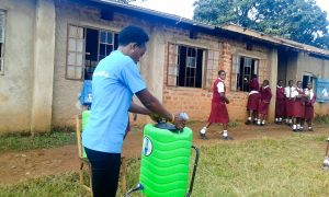 The Water Project:  Trainer Setting Up Handwashing Station