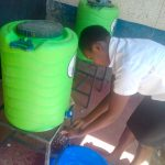 The Water Project: Imusutsu High School -  Sharon Iminza Washing Her Hands