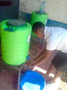 The Water Project:  Sharon Iminza Washing Her Hands