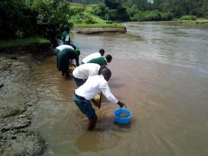 The Water Project:  Students Fetching River Water
