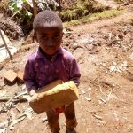 The Water Project: Irumbi Community A -  A Little Boy Delivering A Brick To The Artisan