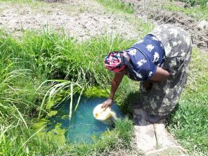 The Water Project:  Vulenywa Fetching Water
