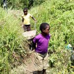 The Water Project: Burachu B Community A -  Children Carrying Materials To The Artisan
