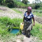 The Water Project: Luyeshe Community, Matolo Spring -  Carrying Water