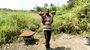 The Water Project:  Ernest Opiyo Carrying Hardcore For Backfilling Purposes