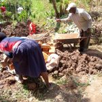 The Water Project: Irumbi Community A -  Delivering Bricks To The Site