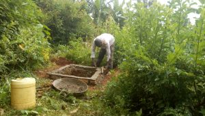 The Water Project:  Finishing The Pit For A New Latrine