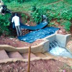 The Water Project: Shirakala Community -  Backfilling